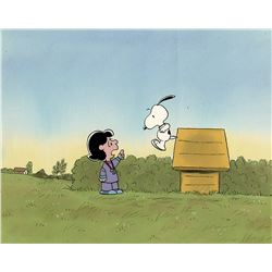 """Snoopy"" and ""Lucy"" production cels on a production background from a Peanuts TV special."