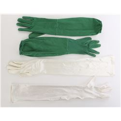 "(2) Pairs of Disney World walk-around Character Gloves: ""Green Army men"" and ""Cinderella""."