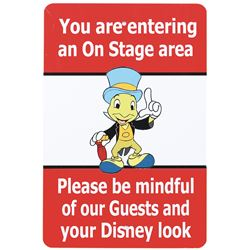 "Disney World on stage ""Jiminy Cricket"" sign and ""Mickey Mouse"" sign."