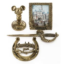 Disneyland (1) framed picture, (1) letter opener, (1) luck charm horseshoe & (1) Mickey paperweight.