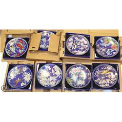 STACK OF EIGHT CHINA COLLECTOR PLATES