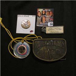 """Brass Belt Buckel """"Raleigh Lights"""" depicts Semi and Trailer; encased 1975 Lincoln Cent with string n"""