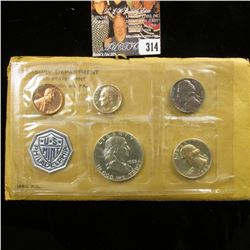 1963 P U.S. Proof Set, Dime is toned, otherwise in original packaging as issued.