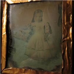 Civil War era embossed leather and wood case with a tin-type of a young girl with a flower bouquet,