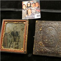 Civil War era embossed leather and wood case with a tin-type of a young boy sitting in a high chair,