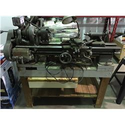 SOUTH BEND PRECISION LATHE MODEL A WITH AN ASSORTMENT OF ATTACHMENTS