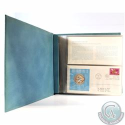 1973 United Nations Sterling Silver Proof Medallic Art First Day Cover Stamp Album. This album conta