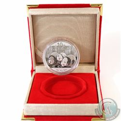 2013 China 1oz Fine Silver Panda (TAX Exempt). Coin comes encapsulated in red clamshell case. Please