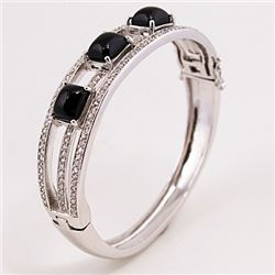 SILVER BANGLE WITH BLACK ONYX AND WHITE TOPAZ