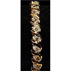 Fancy Cubic Zirconia Gold over Silver Bracelet.