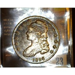 23.    1836 Capped Bust Half Dollar, full original toned EF.