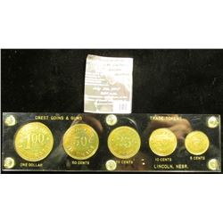 "101.Black Capital holder with gold lettering and a five-piece set of ""Crest Coins & Guns/Buy/Sell/Tr"