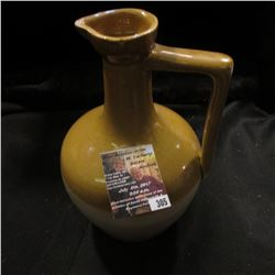 "305.5"" x 8"" Stoneware Pitcher with long narrow handle."
