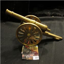 "371.Brass Civil War Style Cannon 7 1/4"" in length. Working wheels and pivots."