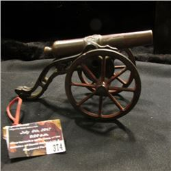 "374.Pre Civil War Cannon, Copper barrel, Iron wheels and frame, star on top of barrel. 6 1/2"" length"