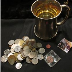 384.Silver Plated Mug with clear glass bottom. Includes a nice mess of unsorted Foreign Coins and To