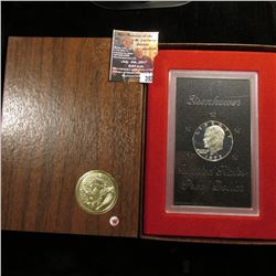 392.1973 S Eisenhower Proof Silver Dollar in original brown box of issue.