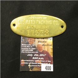 "400.Brass oval-shaped box tag ""Property of The Rath Packing Co. Waterloo, Iowa 11573""."