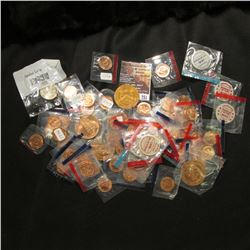 751.Nice Ziplock bag full of U.S. Mint Medals, most of which are in original cellophane.