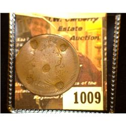 1009.         1798 U.S. Large Cent struck slightly off center with five circular counterstamps on th