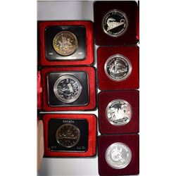 ( 7 )  DIFFERENT CANADIAN 50% SILVER DOLLARS IN ORIGINAL BOXES: SEE PICTURES
