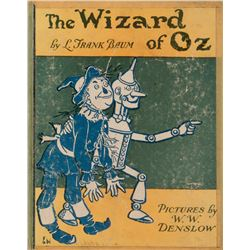 The Wizard of Oz book signed by major cast including Toto's paw prints & Judy Garland inscribed.