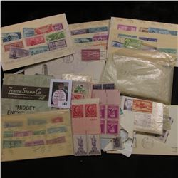 Large group of U.S. Mint & Used Postage Stamps including Singles, blocks, and Plate blocks.