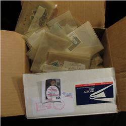 Large group of Foreign and possibly some U.S. Postage Stamps. I never had time to sort so, this barg