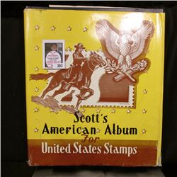 """Scott's American Album for United States Stamps"" with hundreds of old U.S. Stamps, 1966 Edition."
