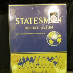 "1979 ""Statesman Deluxe Stamp Album"" with hundreds of Foreign and some U.S. stamps."