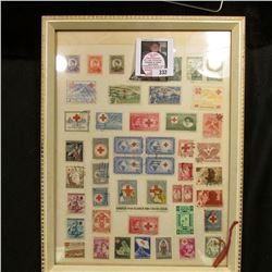 Glass frame full of Red Cross Stamps from around the World.