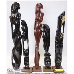 FLAT OF CARVED WOOD FIGURES ON STANDS