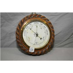 "Vintage wall mount barometer with carved wooden frame, 7"" in diameter"
