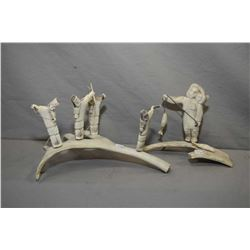 "Two Inuit antler carvings including a four person spear hunting team 11"" across and a mother and chi"