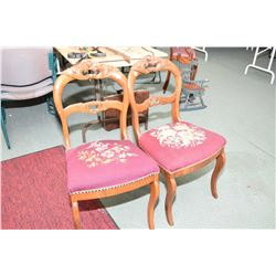 Pair of matching mid 20th century needle point upholstered side chairs with carved floral decoration