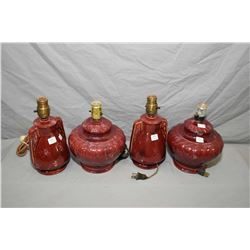 Two pairs of glazed Medalta Pottery lamps, all in matching burgundy colour including No.238 and No.