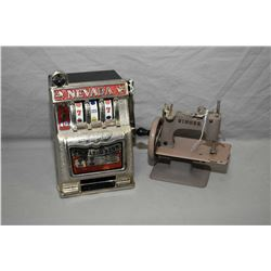Miniature Singer sewing machine and a Nevada Buckaroo bank