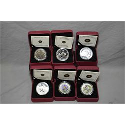 Six Royal Canadian mint boxed coins 2009 Brilliant non-circulated dollar, 2009 Proof silver dollar,