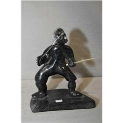 """Carved Inuit soapstone of a warrior with tusk spear signed by artist Lyta Josephie 8 1/2"""" in height"""