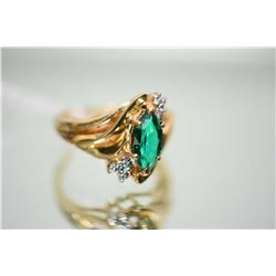 Ladies 10kt yellow gold, simulated emerald and diamond ring set with 0.02ct single cut diamonds. Ret