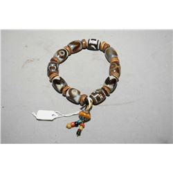 Sino-Tibetan ceremonial Dzi bead bracelet with bone separator
