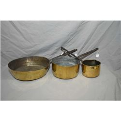 Selection of brass pots with steel handles