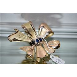 Ladies vintage 14kt yellow gold and blue sapphire bow shaped brooch hallmarked Hungary. Set with 1.6