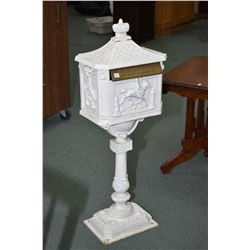 "Cast iron horse and rider motif free standing letter box, 45"" in height"