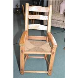 Primitive hand made pine arm chair with rush seat