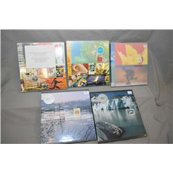 "Five new and unopened Canada Post ""Collection Canada"" stamp books with stamps including 2000, 2001,"