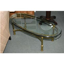 Brass based and glass topped quality oval coffee table