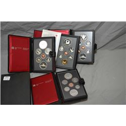 Four double dollar Mint sealed coin sets including 1980, 1982, 1983 and 1988