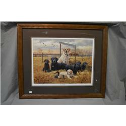 "Two framed Ducks Unlimited limited edition prints including ""Rookie, Chocolate Lab"" pen signed by ar"