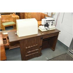 Kenmore Model 158.19412 electric sewing machine in cabinet